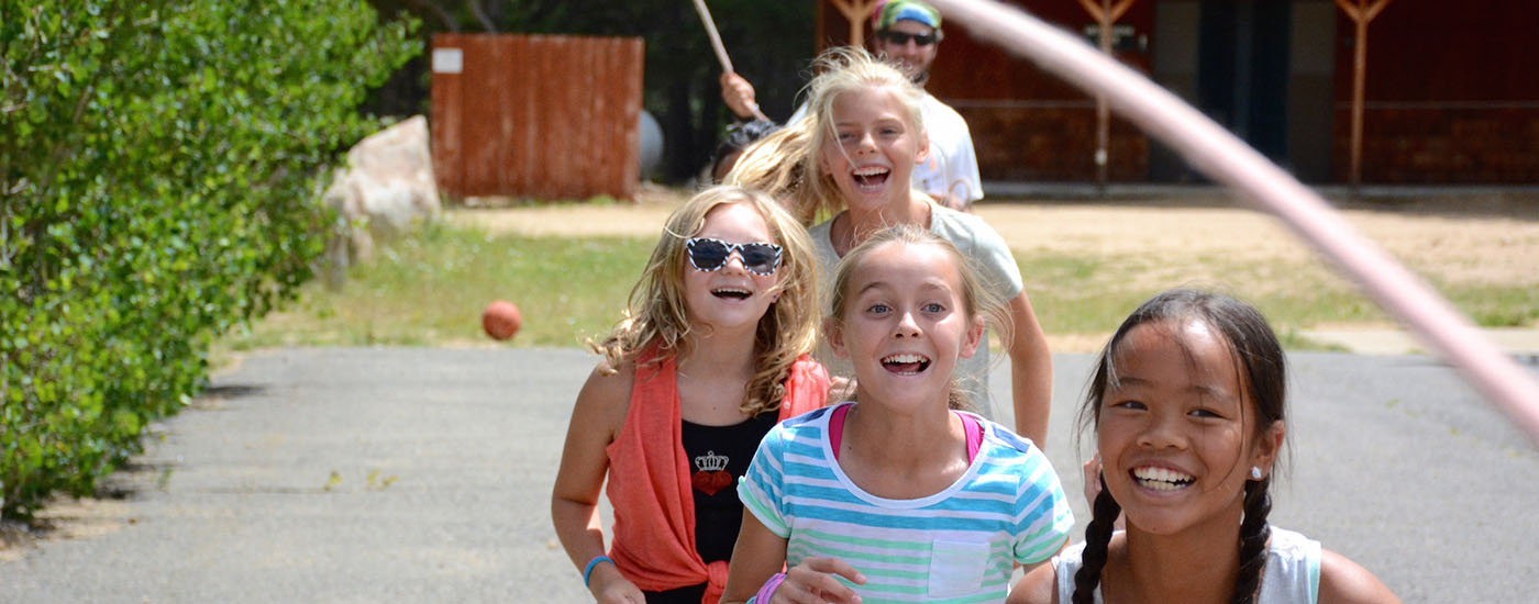 Campers jumping rope with big smiles